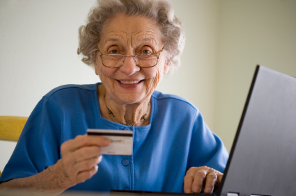 Elderly woman shopping online